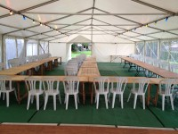 9m marquee layout with trestle tables