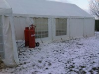 Gas Heater being used in the Snow