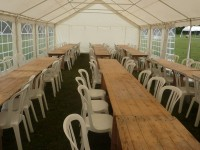 Trestle table layout in a 6m wide Marquee