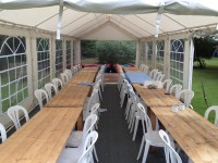 Trestle tables in a 4m wide marquee